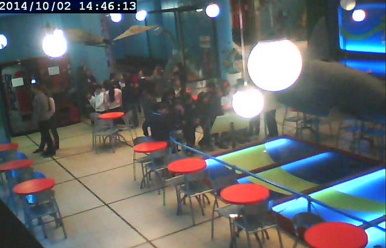 Камера безопасности в аргентинском кафе.