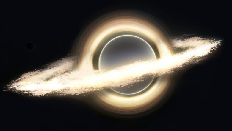 Планета на фоне аккреционного диска чёрной дыры в фильме Interstellar.